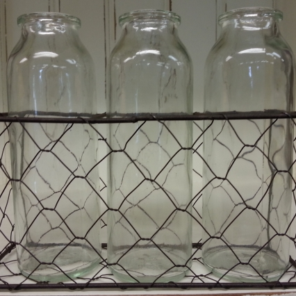 Three Vintage Glass Bottles in Metal Mesh Holder