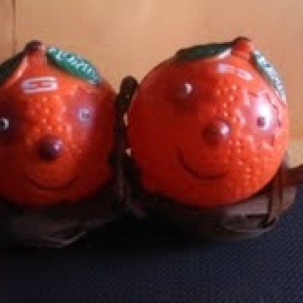 Vintage orange salt and pepper shakers